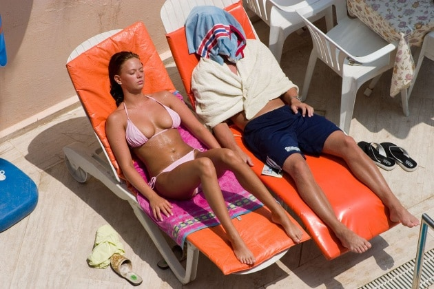 1280px-sunbathing_couple