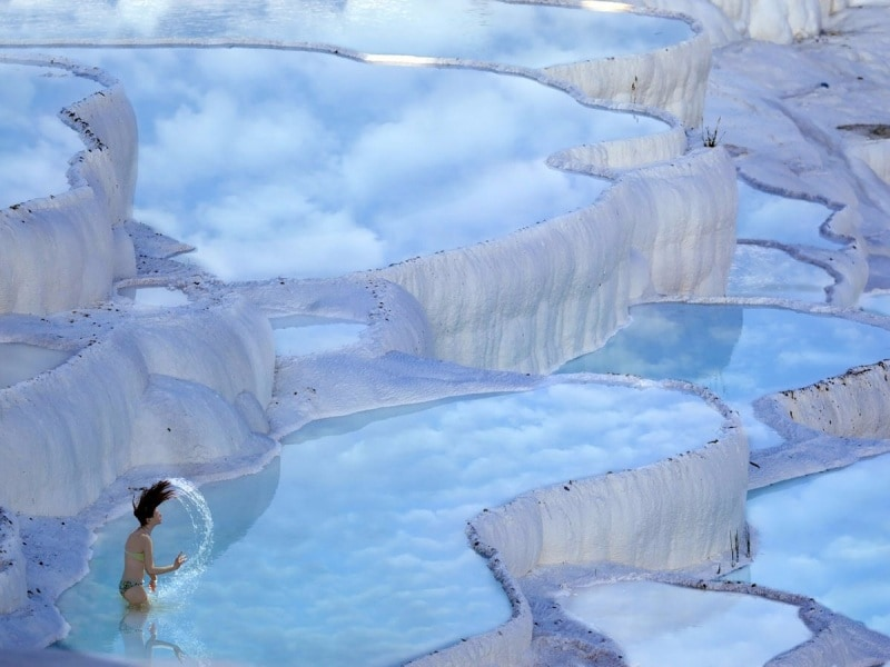 in-the-province-of-denizli-in-western-turkey-the-naturally-terraced-thermal-springs-of-hierapolis-pamukkale-date-as-far-back-as-the-second-century-bc-formed-by-calcite-in-the-water-the-hot-springs-look-like-s