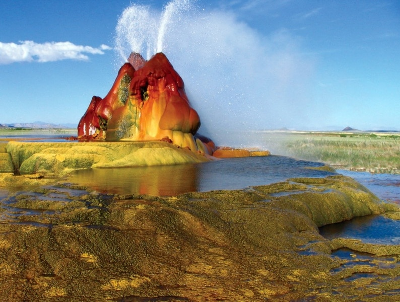nevadas-fly-geyser-located-in-washoe-county-was-created-through-accidental-well-drilling-in-1916-in-the-1960s-the-water-began-escaping-from-the-drilled-location-creating-the-geyser-that-is-known-for-its-stunn