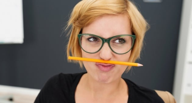 macro-young-pretty-woman-putting-pencil-between-nose-and-lip-at-office1-800x430
