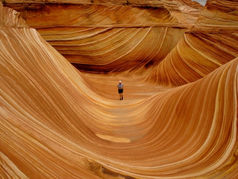 the-wave-is-a-sandstone-rock-formation-located-in-the-paria-canyon-vermillon-cliffs-wilderness-near-the-border-of-arizona-and-utah-its-known-for-its-colorful-and-unique-formations-and-the-difficult-hike-requi