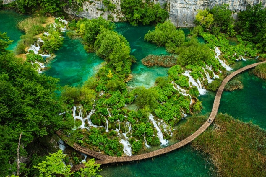 croatias-plitvice-lakes-national-park-is-both-one-of-southeast-europes-oldest-parks-and-croatias-largest-with-16-interlinked-lakes-between-mala-kapela-mountain-and-pljeivica-mountain-the-lakes-are-surrounded-